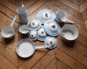 A set of six French vintage floral enamelware pots and pans, with lids