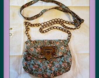 Shoulder bag long strap with chain and same material as bag. Cross over shoulder bag