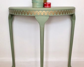 Console table, green with gold embossed stencilling
