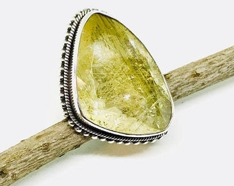 10% Rutilated Quartz Ring set in Sterling silver 925. Size -8. Natural authentic stone. Freeform shape.