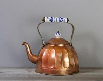 Vintage copper tea kettle with ceramic handle