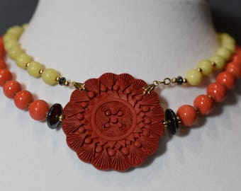 Coral and green choker with soapstone pendant