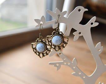 dangling earrings in antique brass and resin