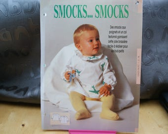 2 patterns: 1 brassiere has smocked baby: T 6.9.12 months. 1 tube dress has rolled collar T 38 to 44.