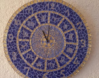 Clock in blue and gold mosaic zodiac sign