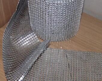 Large, shiny, silver RHINESTONE Ribbon.