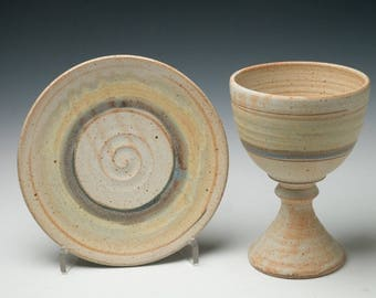 simple pottery communion set , clay chalice and paten