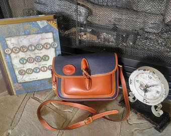 SOLD***Vintage Dooney and Bourke Navy Blue and Brown Leather Purse