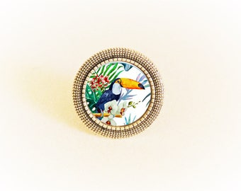 Adjustable silver ring and toucan and tropical flower pattern cabochon