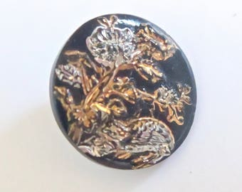 Antique Black Glass Quail Under a Flower With Gold And Silver Decorative Finishes