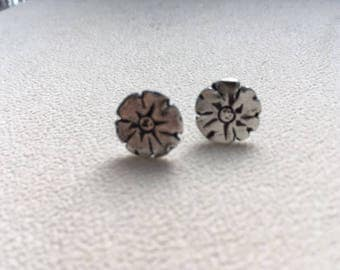 Sterling silver flower post earrings.