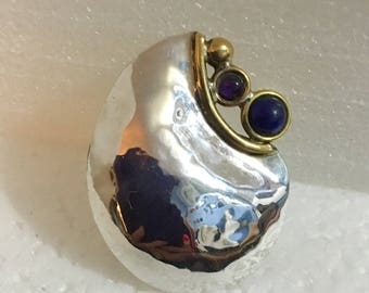 Sterling silver pendant with brass accents and lapis and amethyst stones