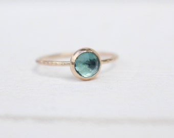 14 k  Gold swiss blue topaz ring