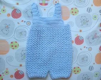 baby in light blue short overalls size 6 months