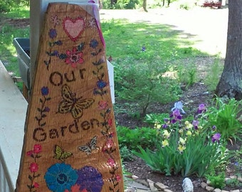 Pyrography wood burned tree trunk wedge garden art with colorful flowers and butterflies says (Heart) Our Garden