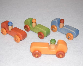 Car racing, convertible, wooden toy, different colors: red, green, blue, yellow.