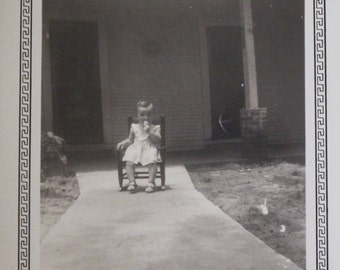 1948 Little Girl Black and White Photograph ~ Small Photo Picture of a Little Girl Sitting on Chair on Sidewalk in Front of House