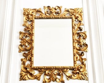 Antique French Grand Mirror, An Opulent Mirror in a Masterfully Hand Carved and Gilded Wood Frame, 19th Century