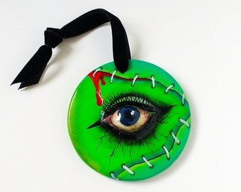 Monster painted ceramic round ornament