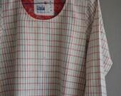 Hand-spun and handwoven khadi top , khadi fabric , hand-loom cotton , khadi garment .