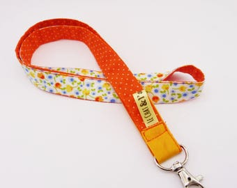 Cord key chain, orange and flowers