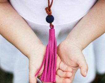 Girls ruby leather tassel necklace with small wool felt pom pom