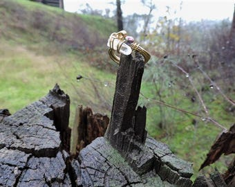Ring Featuring Gold Colored Copper Wire Wrapped Quartz Crystal - Size 10