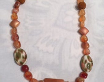Orange glass and gemstone with a hint of green
