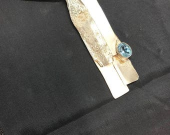 """Organic textured Silver pendant with blue topaz. """"The river 4"""""""