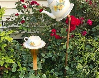 Yellow roses matching tea pot birdfeeder