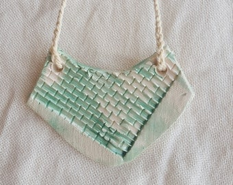 necklace with white ceramic pendant, mixed with planed and scale texture, glazed in mint, boho style, with cotton braided cord