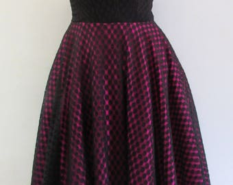Black and pink strapless dress with polkadot overlay