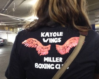 The Kayole Wings Miller Boxing Club Shirt