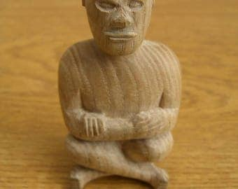 Hand carved wooden cross armed, cross legged man sculpture