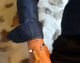 Featuring a tassel and charm Bangle Bracelet