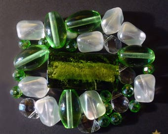 30 white, green of various shapes Indian glass beads