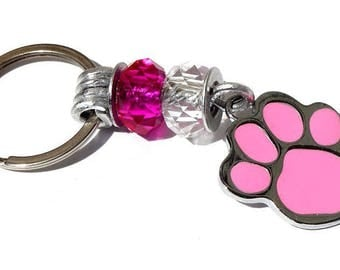 """Keychain featuring a dog paw print and two glass faceted rondelles: """"Paw"""" - pink"""