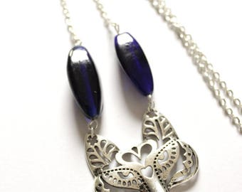Wolf necklace with blue glass beads