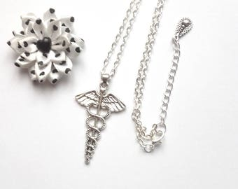 silver plated with snakes and wings pendant necklace