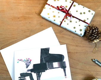 Hilarious Rudolph The Red Nosed Reindeer Playing The Piano Christmas Card