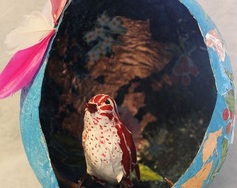Paper mache red and white bird and nest