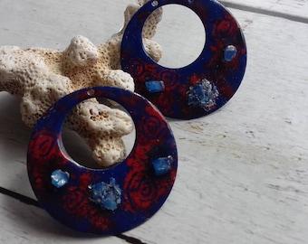 pair of enameled copper artisan charm type red and blue hoop earrings