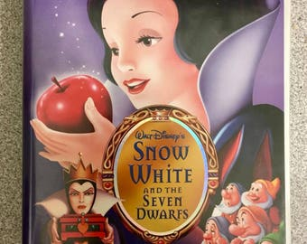 Walt Disney's Snow White and the Seven Dwarfs original VHS tape. (Platinum edition and used)