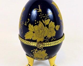 Vintage beautiful Porcelain Dark Blue Egg, with nice Flower Decor and Gold Details