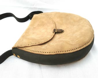Oval woman leather bag