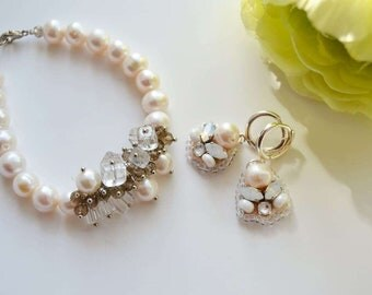 Earrings and bracelet made from natural pearls. Wedding jewelry. Pearl