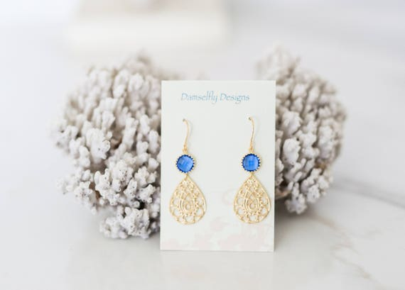 Matte gold Earrings with blue glass