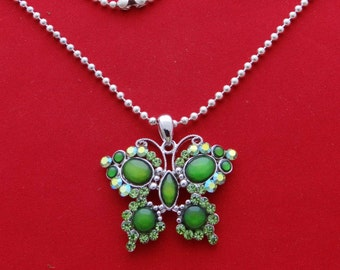 "Vintage silver tone 15"" necklace with 1.5""  rhinestone butterfly pendant with green rhinestones in great condition, appears unworn"