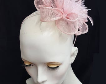 pale baby pink sinamay fascinator with feathers on headband fixing ideal weddings races accessory