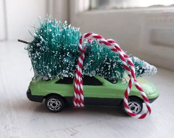 Sea Foam Green Car with Tree Strapped to the Top Ornament by Distinguished Flamingo